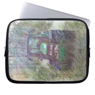 A tractor in the forest laptop sleeves