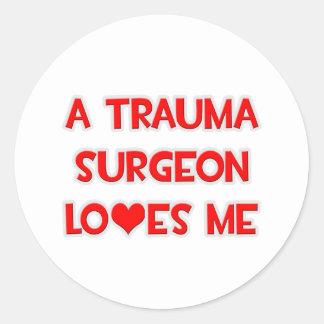 A Trauma Surgeon Loves Me Round Sticker