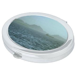 A través de la niebla espejo compacto