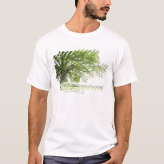 A tree in the field of grass T-Shirt