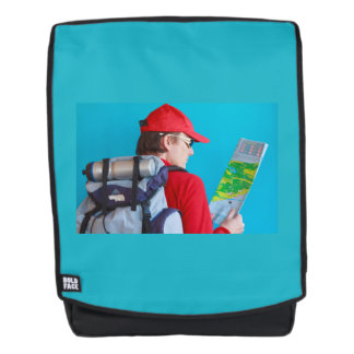 a trekker  with his map and  hi Backpack  + Face