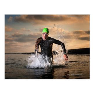 A triathlete at the ocean postcard
