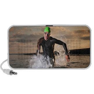 A triathlete at the ocean portable speaker
