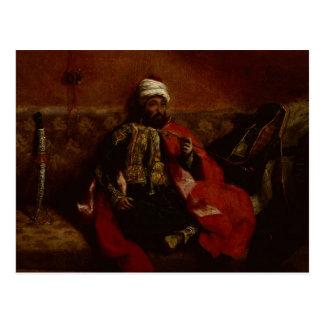 A Turk smoking sitting on a sofa, c.1825 Postcard