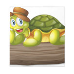 A turtle above a log memo pad