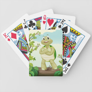 A turtle standing on dry wood bicycle playing cards
