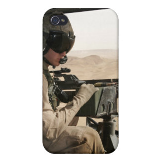 A UH-1N Huey crew chief scans the ground iPhone 4 Case