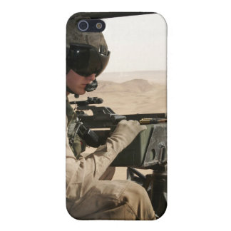 A UH-1N Huey crew chief scans the ground iPhone SE/5/5s Cover