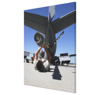 A US Air Force Airman lifts the boom of a KC-13 Canvas Print