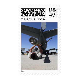 A US Air Force Airman lifts the boom of a KC-13 Postage Stamp