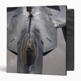 A US Air Force F-22 Raptor is refueled Binder