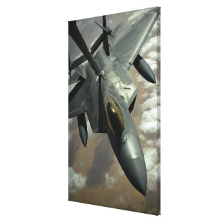 A US Air Force F-22 Raptor is refueled by a KC- Canvas Print
