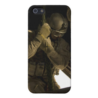 A US Air Force pararescueman begins his descent iPhone 5/5S Covers
