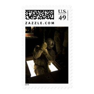 A US Air Force pararescueman begins his descent Stamps