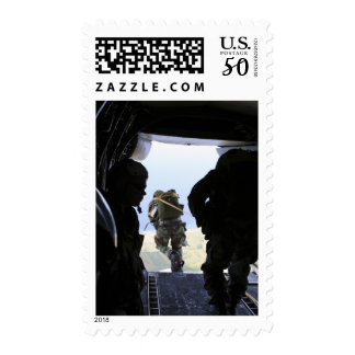 A US Army Soldier performs a static-line jump Postage