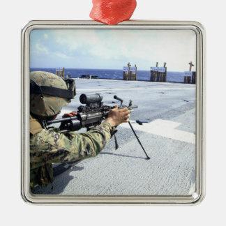 A US Marine adjusting his weapon Metal Ornament