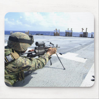 A US Marine adjusting his weapon Mouse Pad