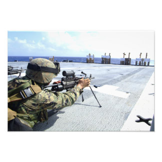 A US Marine adjusting his weapon Photo Print