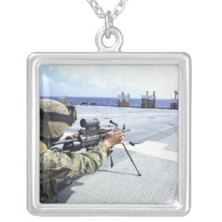 A US Marine adjusting his weapon Square Pendant Necklace