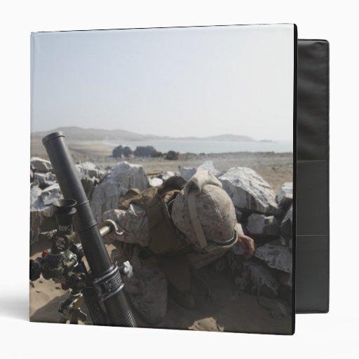 A US Marine fires a mortar in Salinas, Peru 3 Ring Binders