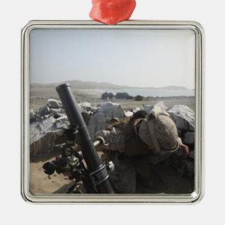A US Marine fires a mortar in Salinas, Peru Metal Ornament