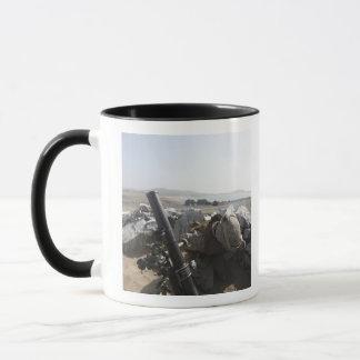 A US Marine fires a mortar in Salinas, Peru Mug