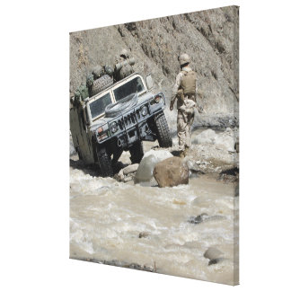 A US Marine guiding the driver of a Humvee Canvas Print