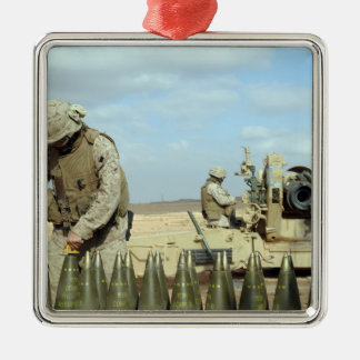 A US Marine prepares howitzer rounds to be fire Metal Ornament