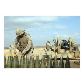 A US Marine prepares howitzer rounds to be fire Photo Print