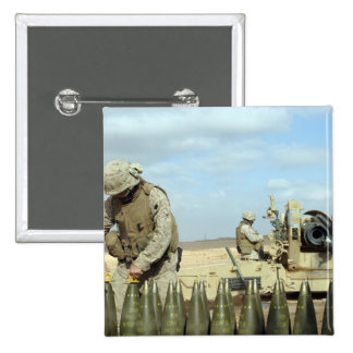 A US Marine prepares howitzer rounds to be fire Pinback Button