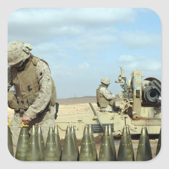 A US Marine prepares howitzer rounds to be fire Square Sticker