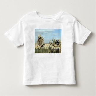 A US Marine prepares howitzer rounds to be fire Toddler T-shirt