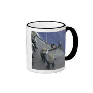 A US Sailor fires a 50-caliber M2HB Coffee Mug