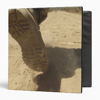 A US soldier walks along a dirt path 3 Ring Binder