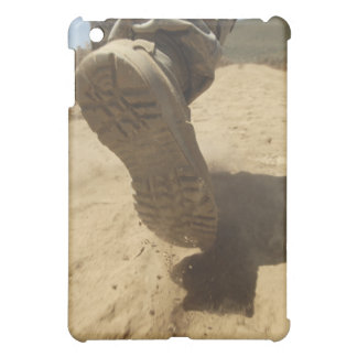 A US soldier walks along a dirt path Case For The iPad Mini