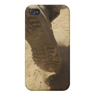 A US soldier walks along a dirt path iPhone 4 Cover