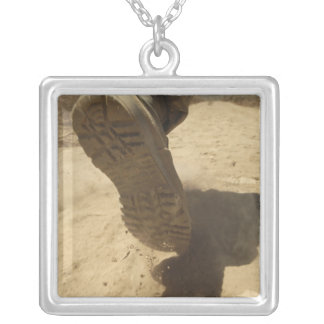 A US soldier walks along a dirt path Silver Plated Necklace