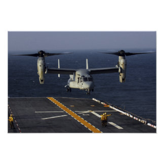 A V-22 Osprey aircraft prepares to land Poster