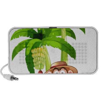 A very happy monkey near the banana plant laptop speakers