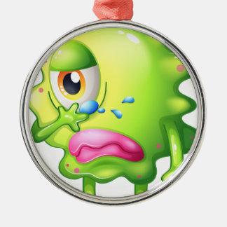A very sad monster round metal christmas ornament