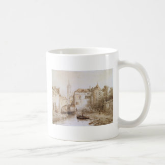 A view of a town with a bell tower coffee mug