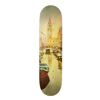 A View Of The Canal With Boats And Buildings Skateboards