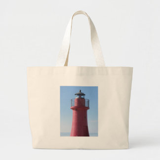 A view of the red harbor lighthouse along the Tusc Large Tote Bag