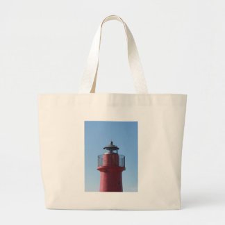 A view of the red harbor lighthouse large tote bag