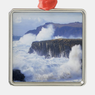 a view of the waves crashing against rocks metal ornament