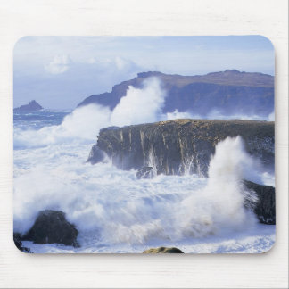 a view of the waves crashing against rocks mousepad