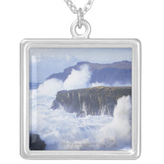 a view of the waves crashing against rocks square pendant necklace