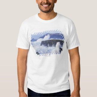 a view of the waves crashing against rocks t-shirts