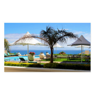 A view over a hotel swimming pool and gardens business card template