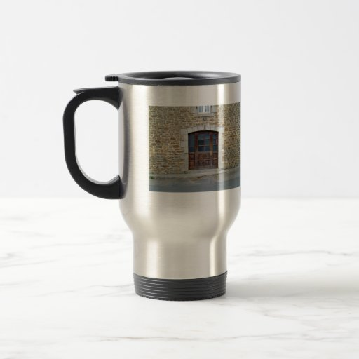 A vintage door and window  in stone wall 15 oz stainless steel travel mug
